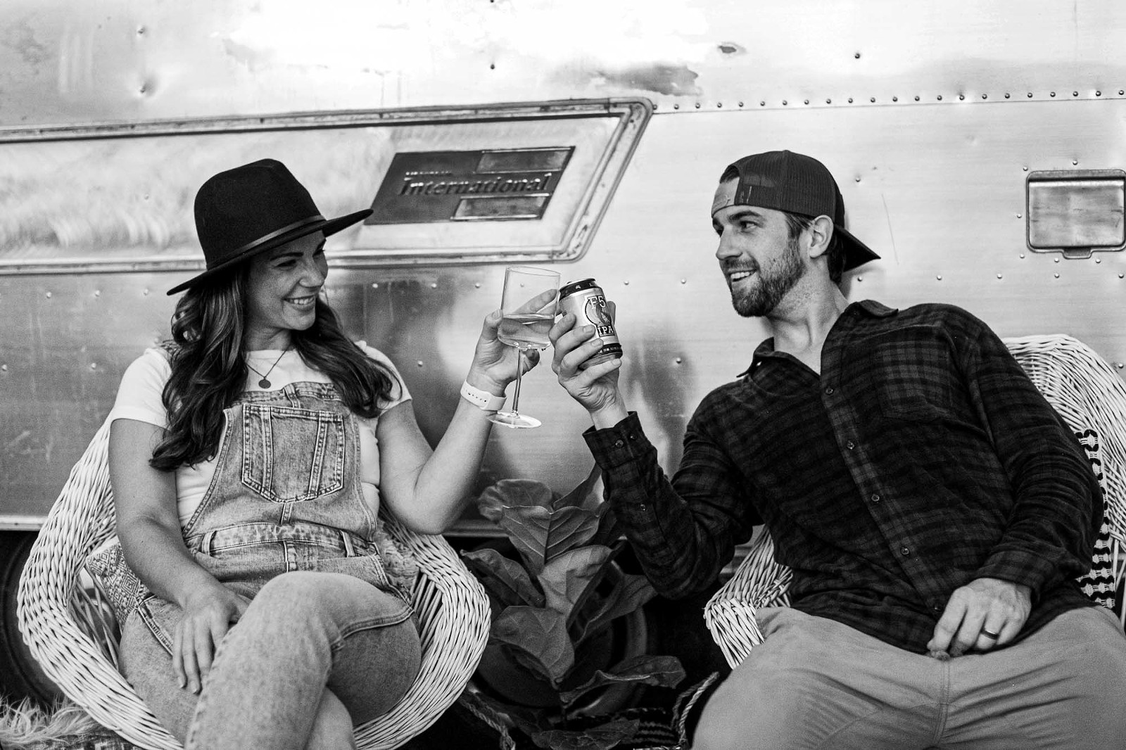 Cute couple enjoying wine by the airstream